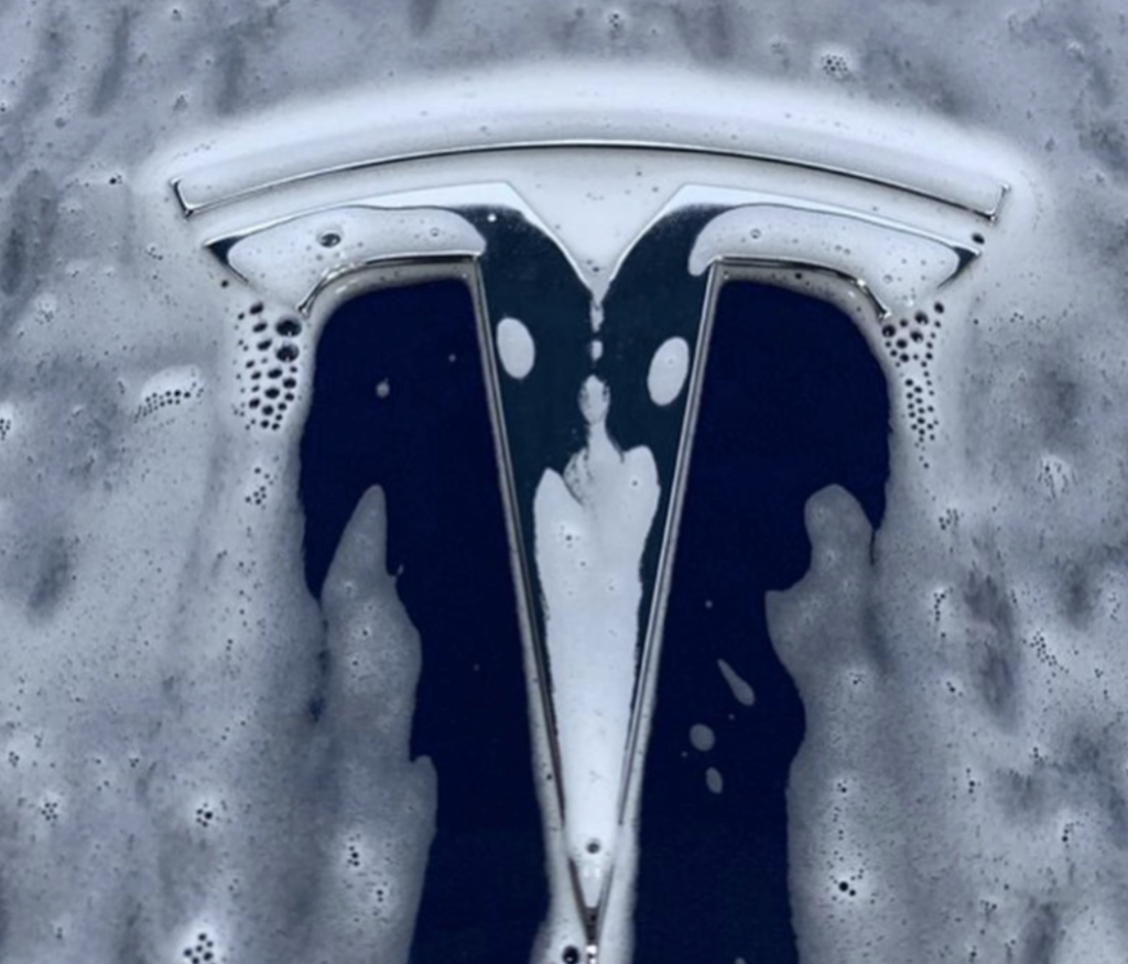 Tesla car being washed.