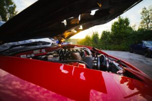 A red car bonnet open.
