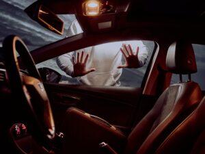 Man Presses On Window of Car