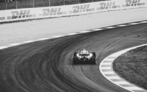Formula 1 race photograph of car in black and white